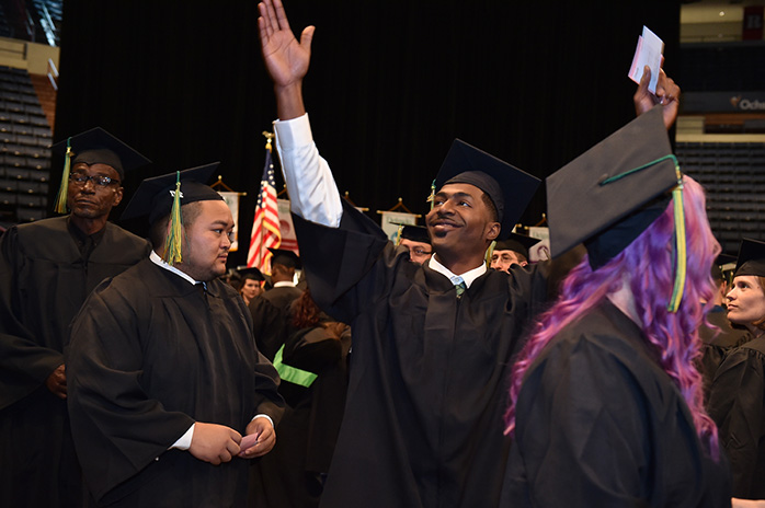 A Delgado graduate celebrates his success at Commencement ceremonies.