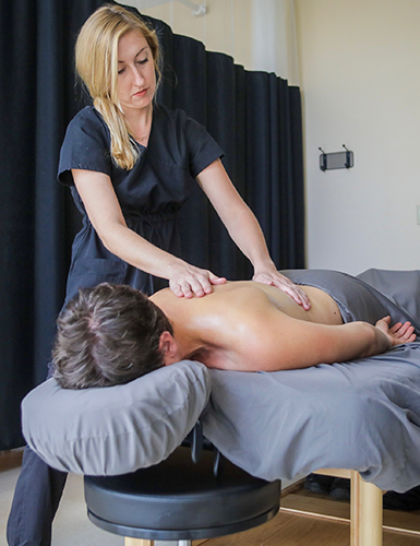 student giving massage to client