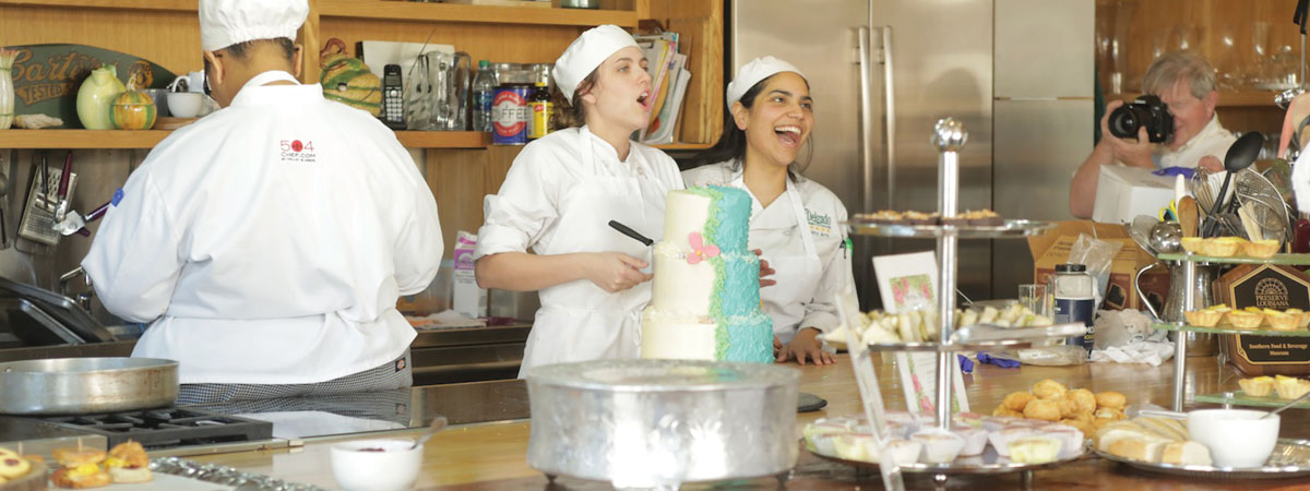 Pastry Arts students laugh as they show off their work