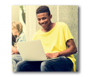 african american male on a laptop