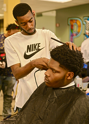 barbering student practicing on another student