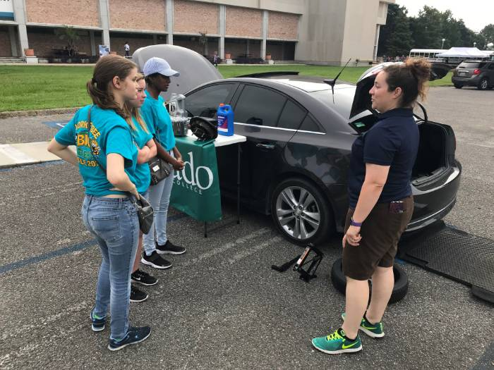 Samantha Candler, instructor of Motor Vehicle Technology, meets with Girl Scouts.