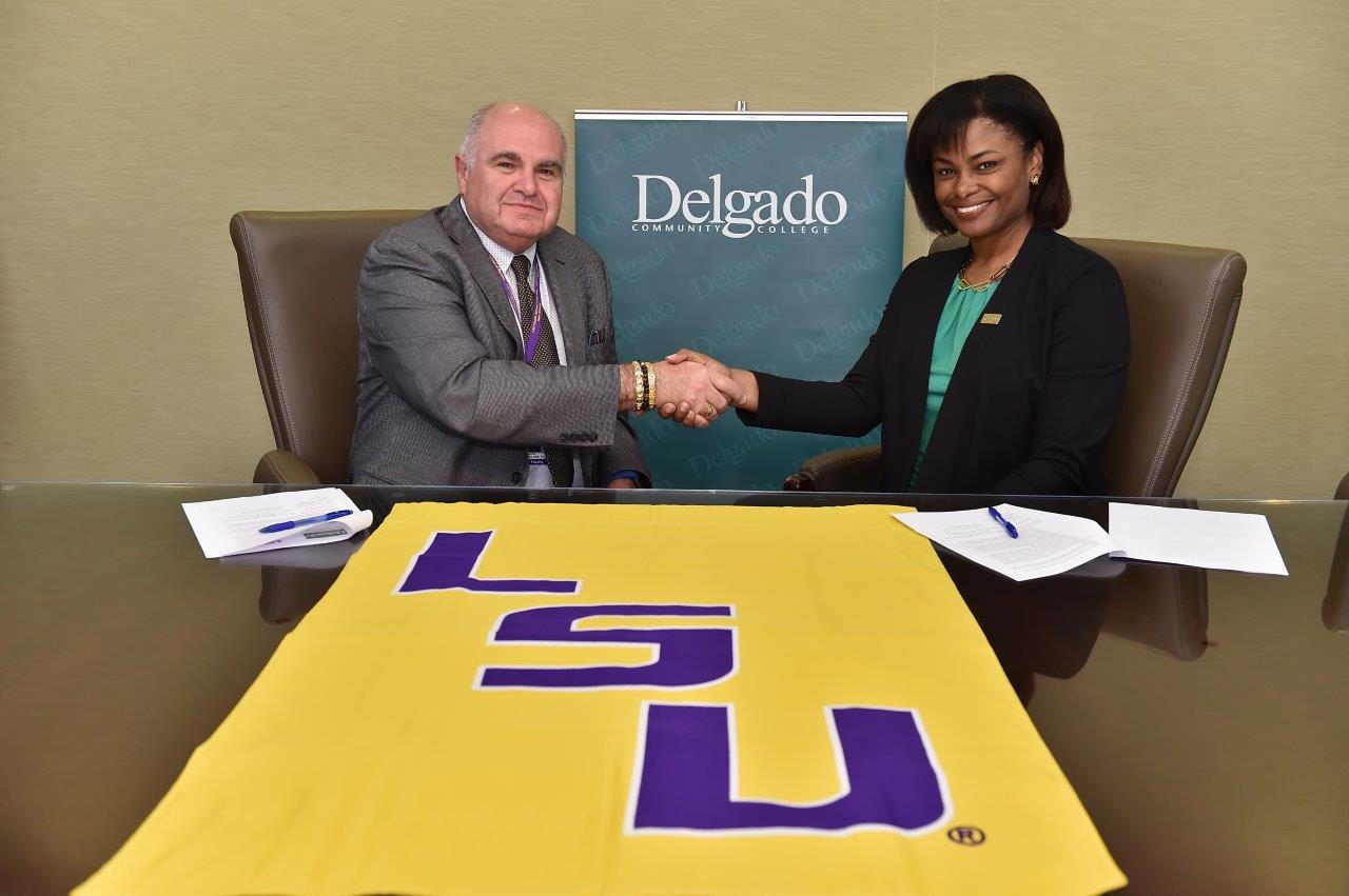 Dr. Demetrius Porche, dean of LSU Health New Orleans School of Nursing, and Joan Y. Davis, chancellor of Delgado Community College, are pictured at a ceremony to formalize a new transfer agreement between the nursing schools at their institutions.