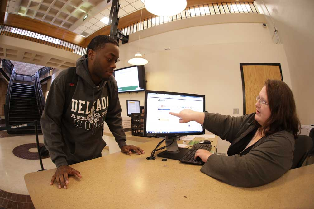 A Delgado student is helped at the Answer Center welcome desk on the City Park Campus.
