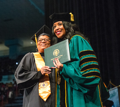 Chancellor Steib with graduating student
